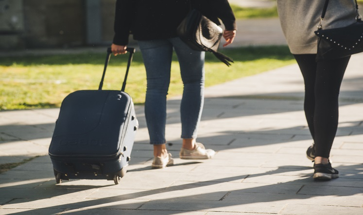 Picture of two people with a suitcase